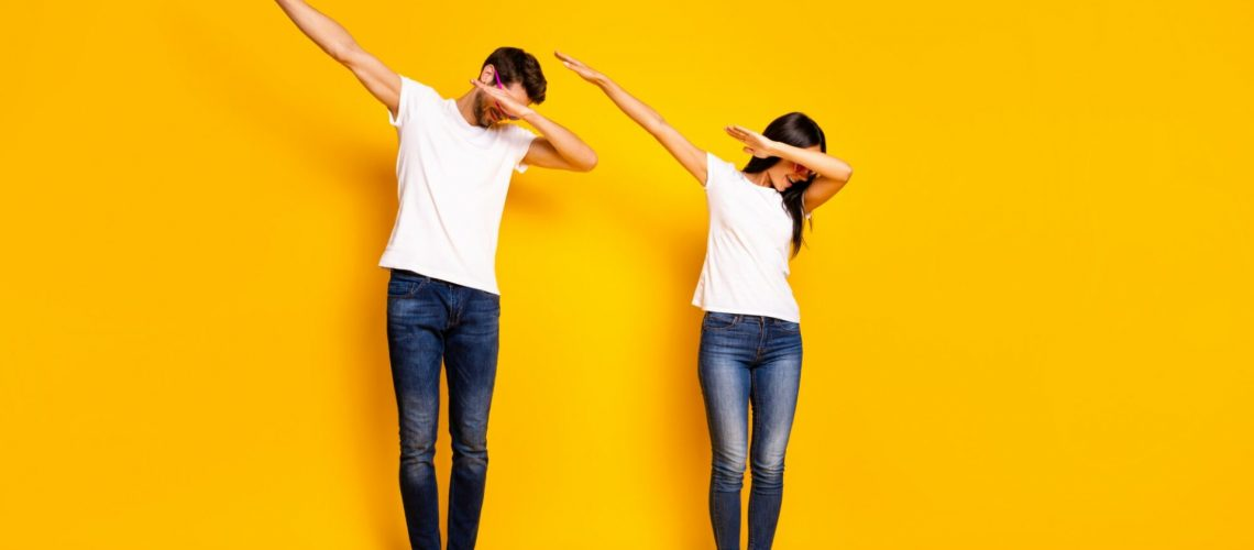 Full body photo of two people dancing at theme party cool modern, moves wear casual clothes isolated yellow color background